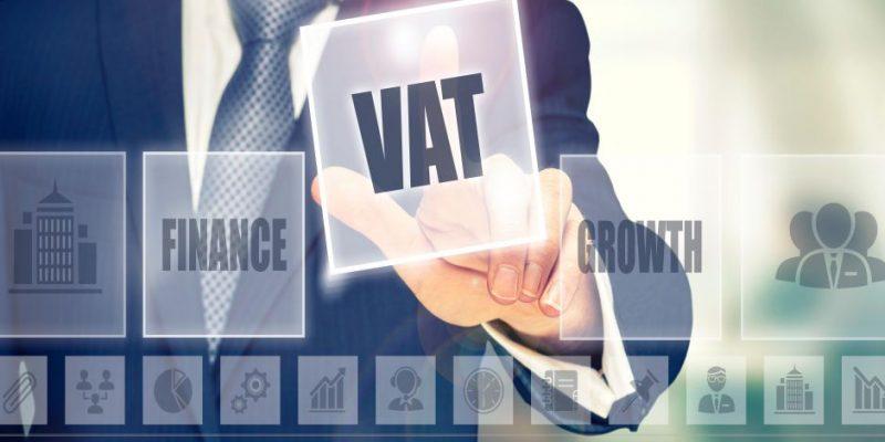 FKNERD Businessman pressing a VAT concept button.